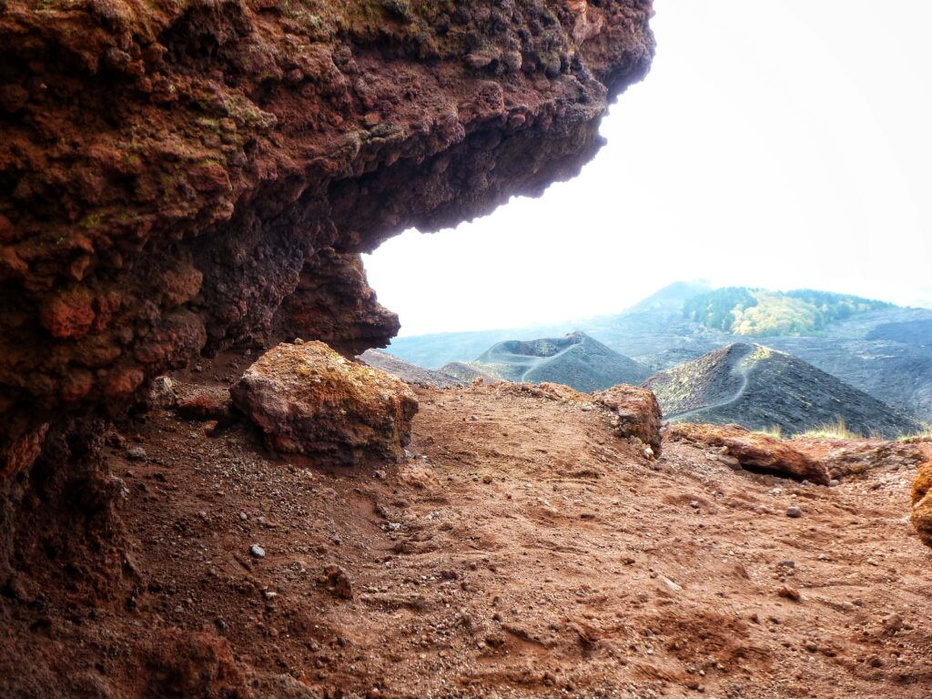 Giant brown and red colored lava rocks on Mount Etna Sicily Italy